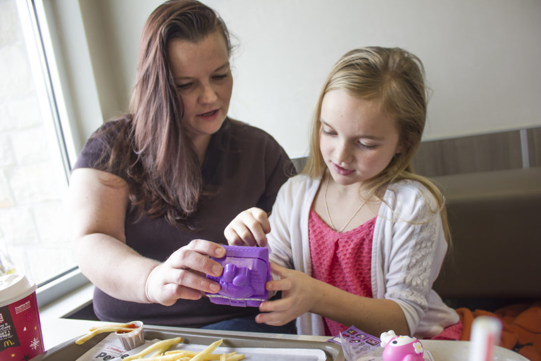 JANELLE PATTERSON   The Marietta Times Melissa Warrener, 36, of Marietta, spends her weekend visit with her daughter Reese Cottrill, 10, of St. Marys, grabbing lunch in Marietta.