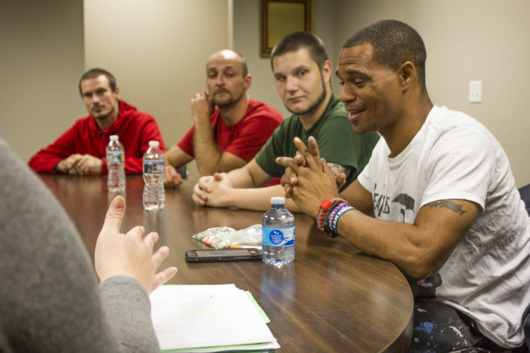 JANELLE PATTERSON   The Marietta Times Left to right, William Carter, 32, of Lowell, Corey Meeks, 31 of Marietta, Anthony Wallace, 25, of Marietta, and Corey Singer, 37, of Marietta, meet at the Marietta Municipal Court for the Thinking for a Change program.