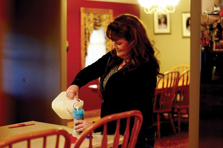 HANNAH KITTLE   The Marietta Times Foster mother Keitha Schilling, 41, of Beverly, pours milk for one of the children in her care. In the past, she has cared for children whose parents had heroin addictions.