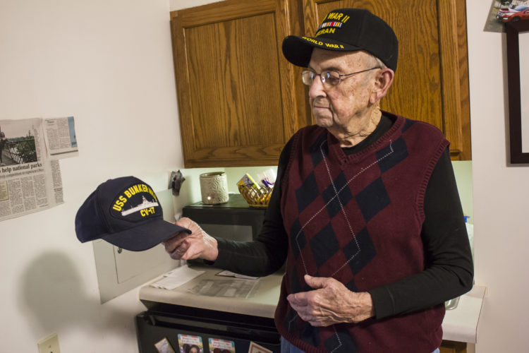 JANELLE PATTERSON   The Marietta Times Ralph Mahoney looks at the cap he earned after serving on the U.S.S. Bunker Hill in World War II.