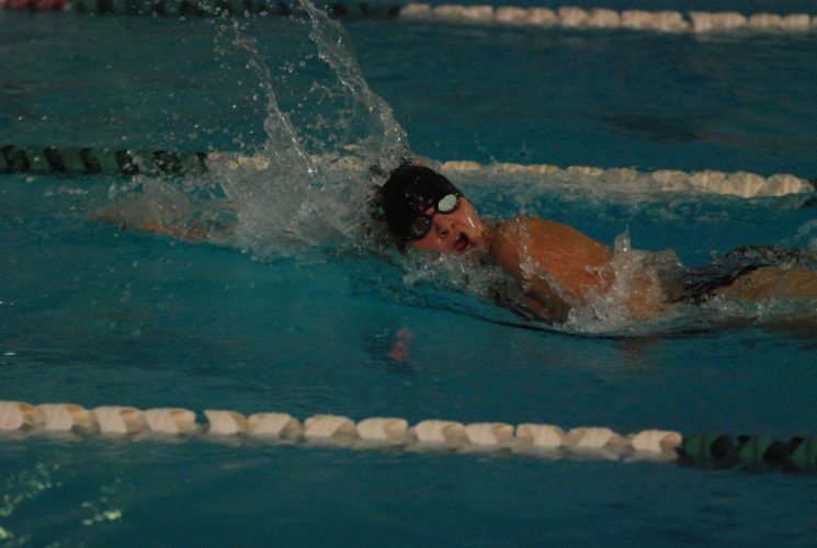 JAY W. BENNETT The Marietta Times Marietta's Alicen Teer anchors the Tigers' runner-up 400 freestyle relay team during a triangular Wednesday at Parkersburg's YMCA.