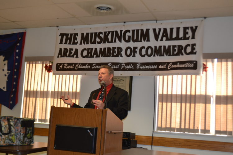 PEYTON NEELY   The Marietta Times Rick Walters, chairman of the Muskingum Valley Area Chamber of Commerce, announces the merger with the Beverly-Waterford Area Chamber of Commerce during the monthly luncheon on Wednesday in Beverly.