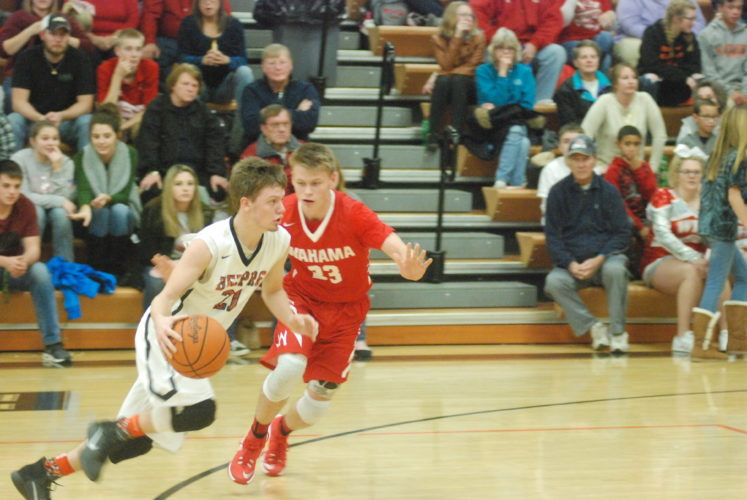 MIKE MORRISON The Marietta Times Belpre's Mythius Houghton (21) tries to get past Wahama's Travis Kearns (23) during a high school basketball basketball game Friday.
