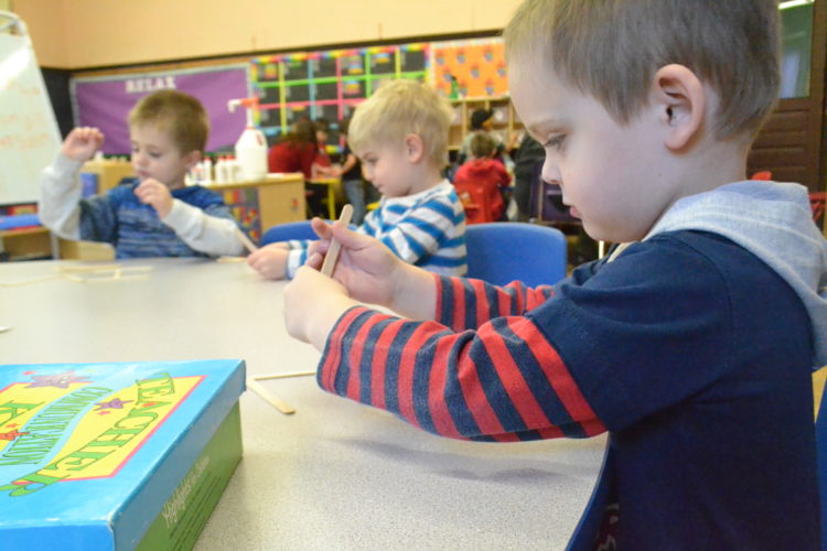 PEYTON NEELY   The Marietta Times Roman Hardie, 4, makes letters out of popsicle sticks with classmates Tucker Frick, 4, and Dylan Coombs, 5, during class on Monday at the Jane Edwards Head Start Center in Marietta.