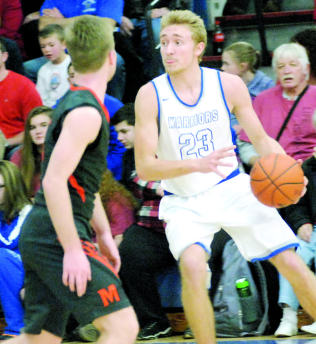 JORDAN HOLLAND The Marietta Times Warren's Chase Weihl (23) handles the ball as Marietta's Gage Herb looks on during a high school boys basketball game Tuesday in Vincent. Weihl scored a game-high 20 points as Warren won, 78-61.