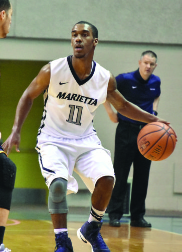Times file photo Marietta College's Keith Richardson handles the ball during a college men's basketball game earlier this season. Richardson scored 30 points to lead the Pioneers past Mount Union Wednesday at Ban Johnson Arena.