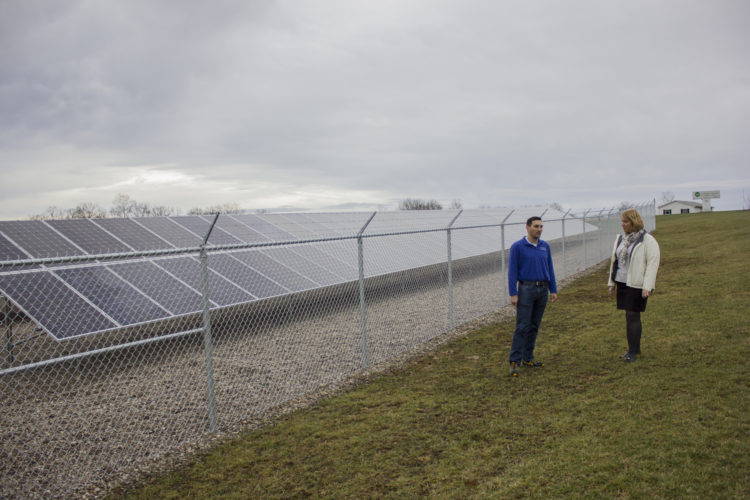 JANELLE PATTERSON   The Marietta Times Nathan Whitacre and Jennifer Greene talk about the output of the new solar panels at Washington Electric Cooperative Wednesday.