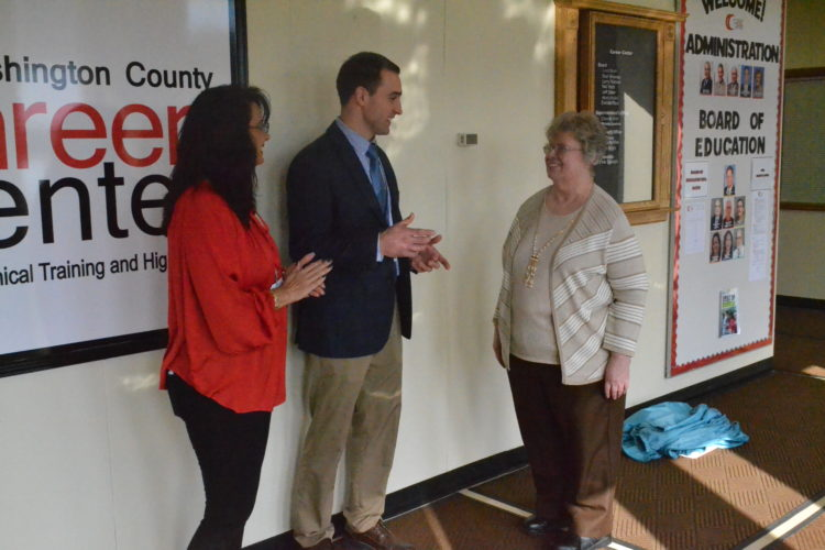 PEYTON NEELY   The Marietta Times Lenora Lada, Medical Program coordinator, and Tony Huffman, director of Adult Training, speak on behalf of the Washington County Career Center to Sister Molly Bauer from the Sisters Health Foundation during a visit to the career center on Friday.
