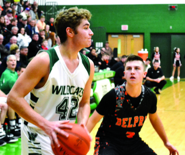 RON JOHNSTON The Marietta Times Waterford's Travis Pottmeyer, left, looks to pass as Belpre's Cole Knotts defends during a high school boys basketball game Friday night at the Harry Cooper Annex inside Waterford Elementary.