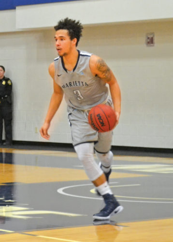 Marietta College's Anthony Wallace dribbles up the court at the BanJo. He scored a game-high 24 points to lead the Pioneers to a 94-72 win against Heidelberg University. Photo by Ron Johnston.