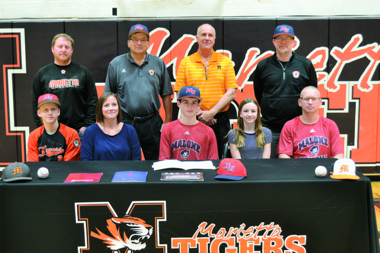 RON JOHNSTON The Marietta Times Marietta High senior Turner Hill signed with Malone University to play baseball Wednesday at Sutton Gymnasium. Sitting: Kail Hill (brother), Nicole Hill (mother), Turner Hill, Addie Hill (sister), Steve Hill (father). Standing: MHS assistant baseball coach Scott Hollister, MHS head baseball coach Jim Thrash, MHS AD Rick Guimond, MHS assistant baseball coach Josh McKitrick.