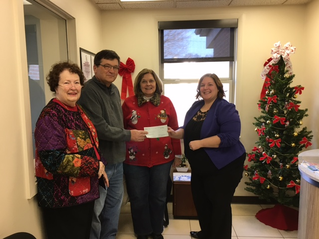 From left, Virginia Buzzard (Marietta High School Alumni and Friends Foundation), Jim Thrash (Marietta High School Alumni and Friends Foundation), Jill Harry (Marietta High School Alumni and Friends Foundation) and Danielle Allphin (Peoples Bank - Reno Branch Manager).