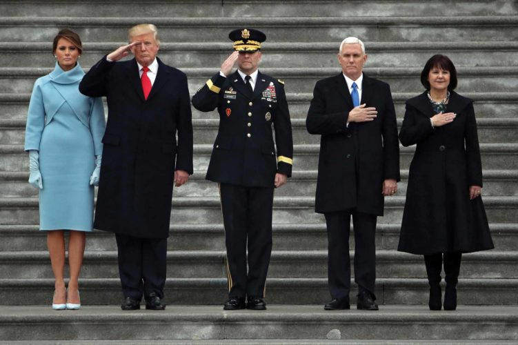 Maj. Gen. Bradley Becker, center, son of Marietta High School graduates, stands with President Donald Trump, first lady Melania Trump, Vice President Mike Pence and his wife Karen Pence, as they review troops on the East Front of the Capitol in Washington, Friday during the presidential inauguration ceremony.