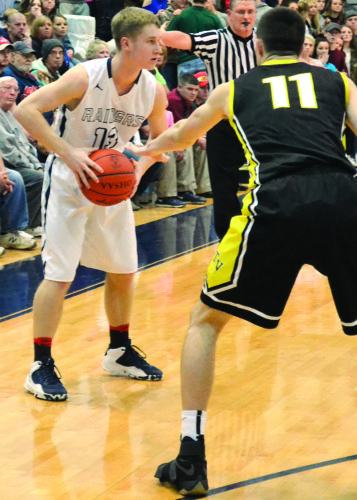 RON JOHNSTON The Marietta Times Morgan's Jordan Work, left, looks to pass as Tri-Valley's Jake McLoughlin defends during a high school boys basketball game Friday night in McConnelsville. Tri-Valley won, 56-48.
