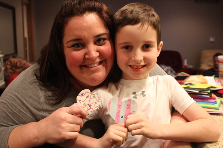 JANELLE PATTERSON   The Marietta Times Duffy Sprague and her son Ayden, of Devola, enjoy crafting together and sharing their valentine love bug bookmarks.