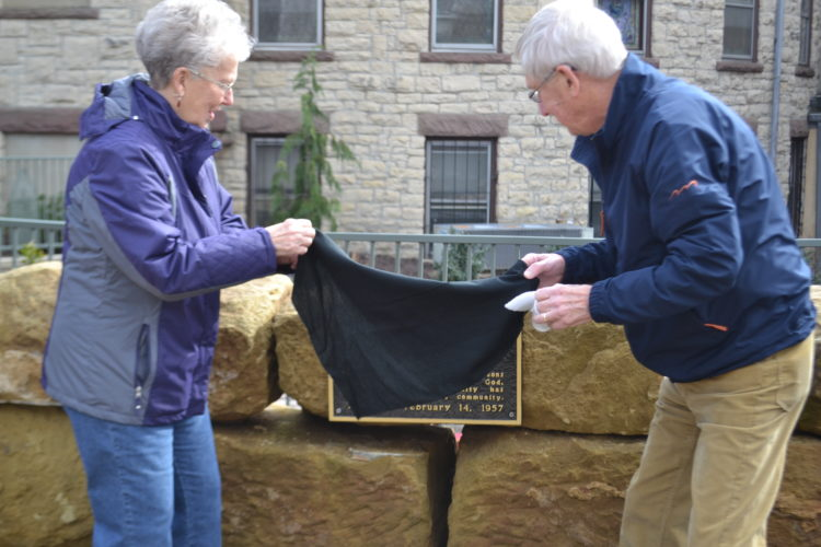 PEYTON NEELY   The Marietta Times Nellie Beardmore and her brother, Bill Hess, both of Marietta, unveil the plaque that honors their late uncle, Dean Hess, at the Memorial Garden beside the First Presbyterian Church on Tuesday afternoon.