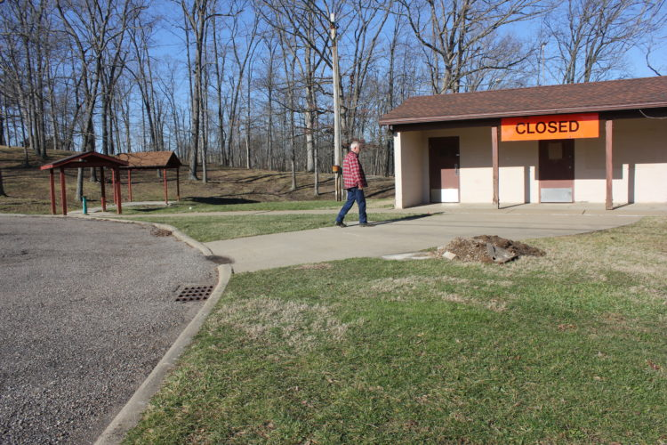 JANELLE PATTERSON   The Marietta Times Barlow Township Trustee Richard Best surveys the closed rest area on Ohio 550 in Barlow Monday.