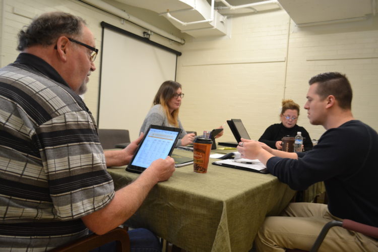 PEYTON NEELY   The Marietta Times Employees of Combined Insurance work together during a business meeting on Tuesday at the Epicenter located on the bottom floor of the Armory on Front Street.