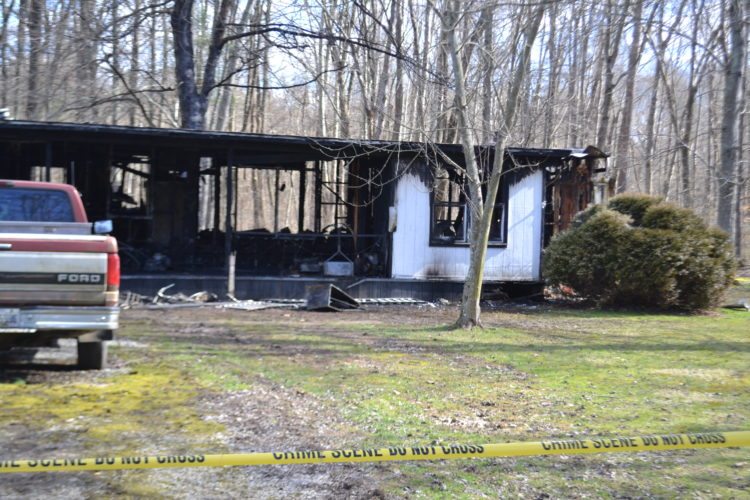 PEYTON NEELY   The Marietta Times This is all that remains of the home at 160 Dana's Run Road in Newport that caught fire Tuesday night, leaving two of the residents dead.