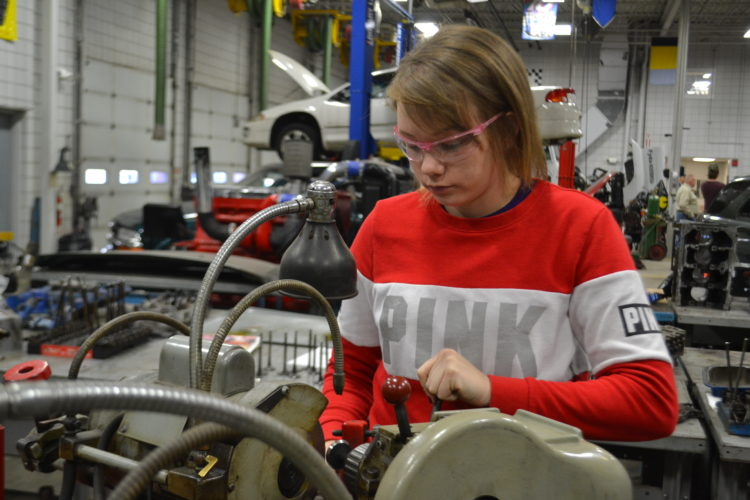 PEYTON NEELY   The Marietta Times Brittany Reed, 20, of Williamstown, works on grinding valves for a truck during her diesel mechanics class on Wednesday.