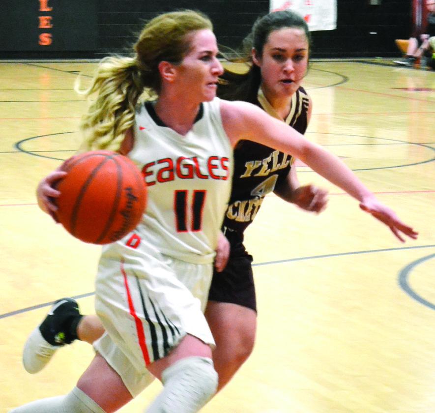 RON JOHNSTON The Marietta Times Belpre's Cheyenne Barker, left, handles the ball as Williamstown's BreeAnn Reynolds defends during a high school girls basketball game Wednesday. Williamstown won, 80-75.