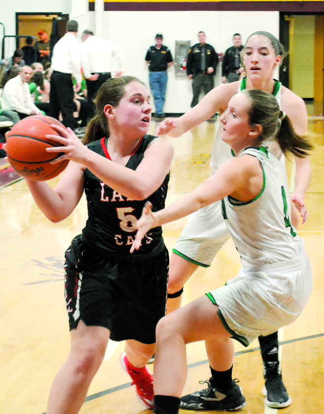 RON JOHNSTON The Marietta Times Trimble's Sydney Hardy, left, looks to pass as Waterford's Emily Kern, right, and Megan Ball defend during a high school girls sectional basketball game Thursday in Pomeroy. Waterford won, 51-24.
