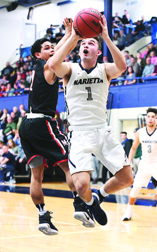 Photo courtesy of Nate Knobel Marietta College's Dillon Young (1) goes up for a basket during a college men's basketball game against Muskingum Wednesday at Ban Johnson Arena.