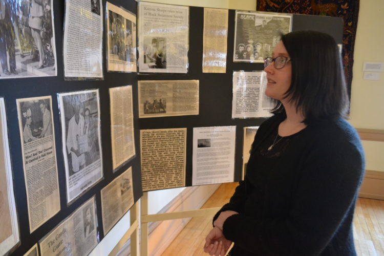 PEYTON NEELY   The Marietta Times Marietta College sophomore Cassie Smith, 19, looks at the Black History display in Andrews Hall on Marietta College's campus Friday afternoon.