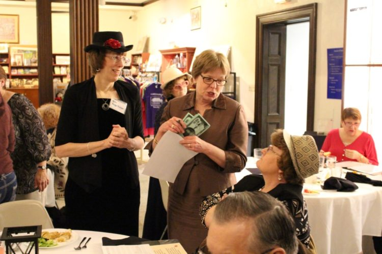 "Photo submitted by Christina Graham, director of marketing for the  Campus Martius Museum. The last murder mystery dinner in March 2016 at Campus Martius Museum featured a mystery based in the unveiling of the ""Lickety-Split Diamond."" Jan Rary, left, and Pam Tilton, right, are seen here bargaining with other mystery participants for clues on the Diamond theft. The upcoming theater night will follow the case of a rock star in town for a ""killer concert."""