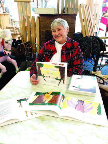 """MaryAnn Sandstrom takes part in a book signing for her children's book """"Cady Cicada Goes UP TOP"""" in January.  Photo submitted by MaryAnn Sandstrom"""