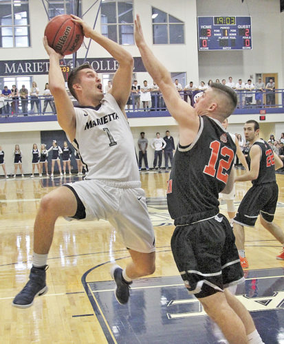 Marietta College's Dillon Young attempts to shoot against an Ohio Northern player during a college basketball game Saturday. Photo by Tom Perry.