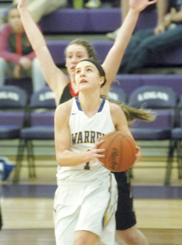 Warren's Katie Liston drives for a basket in sectional tournament action Saturday afternoon at Logan High School. The Warriors scored a 52-42 win over Fairfield union to claim a sectional championship. Photo by Mike Morrison.