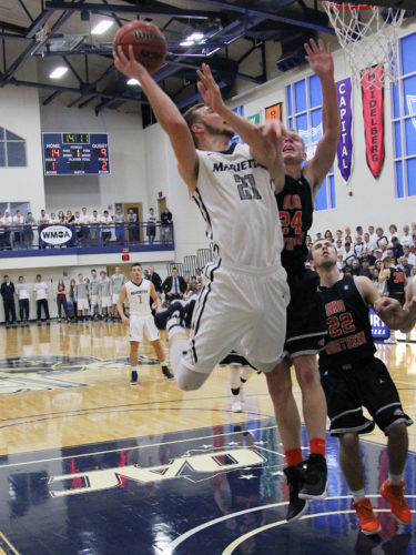 TOM PERRY The Marietta Times Marietta College's Kyle Dixon (21) goes up for a basket during a college men's basketball game against Ohio Northern Saturday at Ban Johnson Arena.