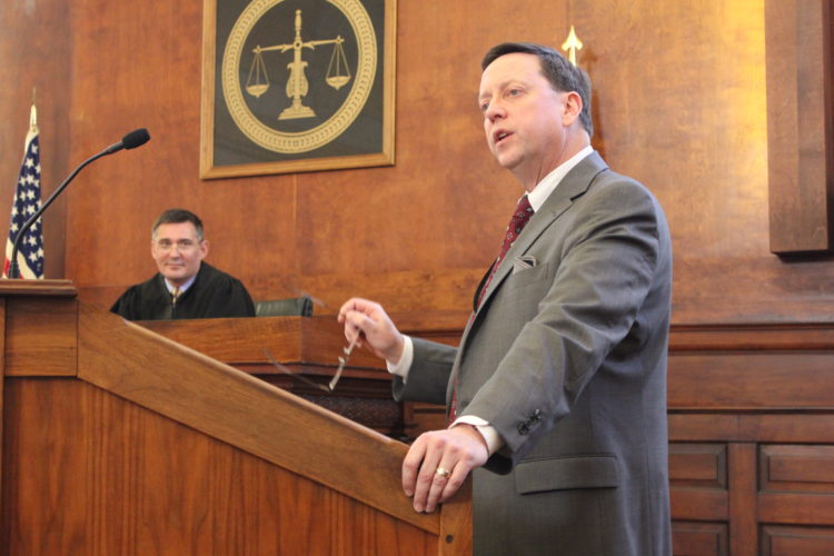 JANELLE PATTERSON   The Marietta Times Washington County Common Pleas Judge Mark Kerenyi, left, and Washington County Prosecutor Kevin Rings, right, play the parts of justice and plaintiff attorney in The Castle's History on Trial program at the Washington County Courthouse Monday.
