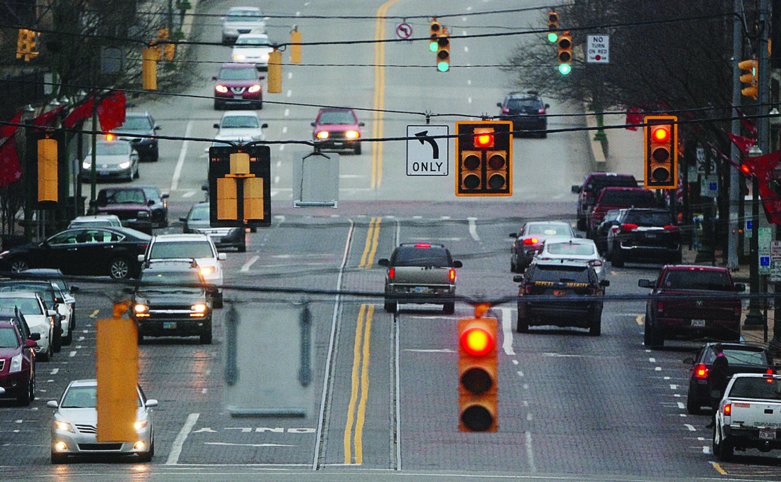 ART SMITH   The Marietta Times Red lights change on Putnam Street during the 5 o'clock hour in Marietta. A new law would enable drivers to proceed through red lights they believe are broken.