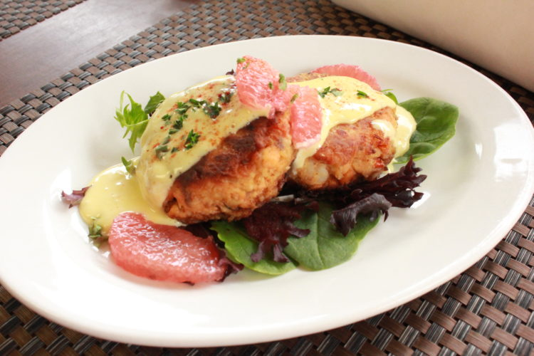 JANELLE PATTERSON   The Marietta Times Poached salmon cakes on a bed of mixed greens with grapefruit hollandaise sauce is one of the main course options on the table at The House of Wines in Marietta next week for MOV Restaurant Week.