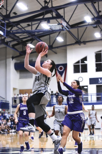 Marietta College's Brooke Borich shoots against a Capital player during a college basketball game Tuesday at Ban Johnson Arena. Photo courtesy of Nate Knobel.