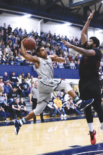 Marietta College's RaNeal Ewing attempts to shoot against a Heidelberg player during a college basketball Tuesday at the Ban Johnson Arena. Photo courtesy of Nate Knobel.