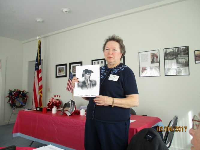 Frances Irvin holding picture of her namesake, Francis Marion.