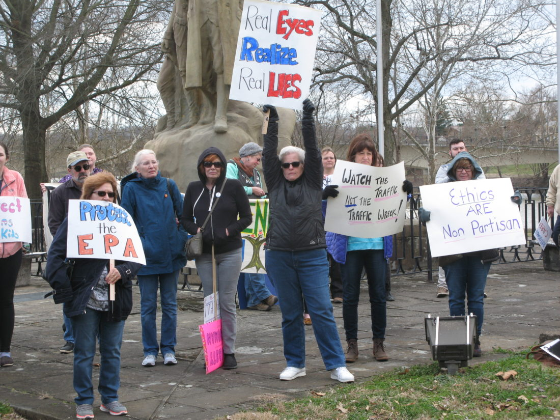 JEFFREY SAULTON  Special to the Times Marietta residents Jayne Stehle, Michelle Stevens and Annelle Edwards hold up their signs during the rally Saturday.
