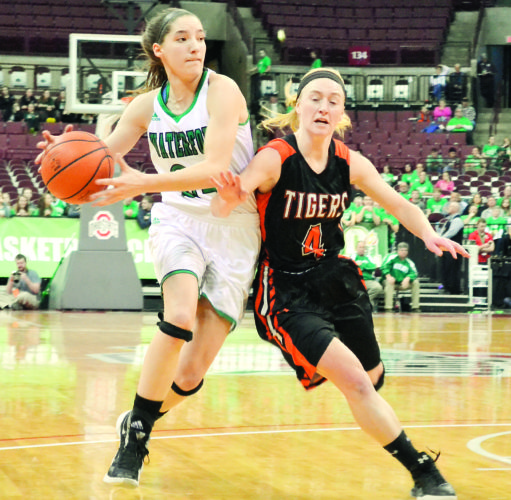 RON JOHNSTON The Marietta Times Waterford's Megan Ball, left, attacks the basket as Jackson Center's Kennadie Reese defends during Thursday's Division IV state semifinal girls basketball game at the Schottenstein Center in Columbus. Waterford won, 37-35.