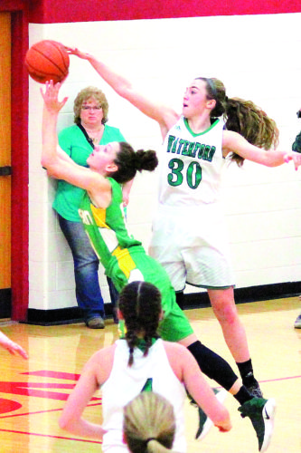 Photo courtesy of Patti Miller Waterford's Alli Kern, right, goes up for a block during a high school girls basketball game against Eastern earlier this season.