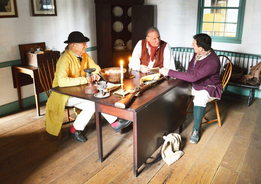 DOUG LOYER  Special to the Times Winthrop Sargent, (John Conklin), Rufus Putnam, (Bill Reynolds), and an Ohio Company director, (Rob Gorrell), reenact a meeting from 1791 in the Rufus Putnam house at Campus Martius Museum.
