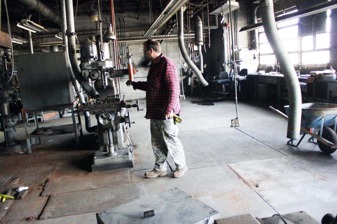 JANELLE PATTERSON   The Marietta Times On Monday, Mike Voshel, of the Williamstown Auction Center, shows that much of the machinery used in the workshops of the Fenton Glass factory are still operational and will be up for auction in the coming weeks.
