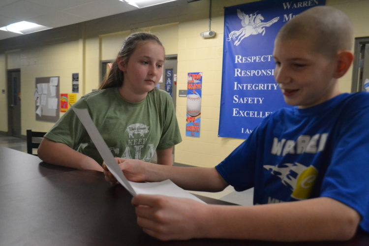 PEYTON NEELY   The Marietta Times Warren Middle School students Justin Pate, 13, and Olivia Byrd, 11, study for the upcoming Marietta Times Regional Spelling Bee during school on Wednesday.