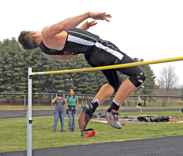 Marietta's Travis Moore had the best individual high jump at 6-feet-2 inches to help the Tigers win the event and the overall points title at Saturday's Fair Weather Relays at Warren High School. Photo by Tom Perry.