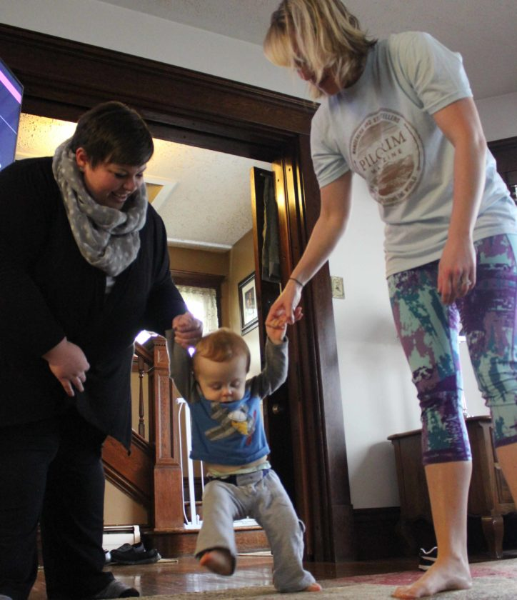 JANELLE PATTERSON   The Marietta Times Heather Hess, left, and Jana Beardmore, right, work on walking with Issac Beardmore, center, during an early intervention visit Monday in Marietta.