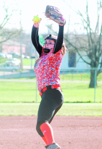 Marietta's Jillian Middleton delivers a pitch in Wednesday night's game against Cloverleaf at Phillips Field. Middleton collected the win while fanning 10 in the Tigers' 5-4, walk-off win.  MIKE  MORRISON The Marietta Times