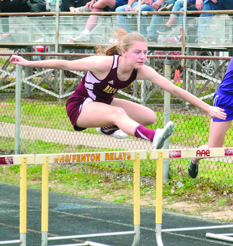 RON JOHNSTON The Marietta Times Williamstown's Lexie Zide competes in a hurdles race at Saturday's Ryan Jobes Invitational in Williamstown.