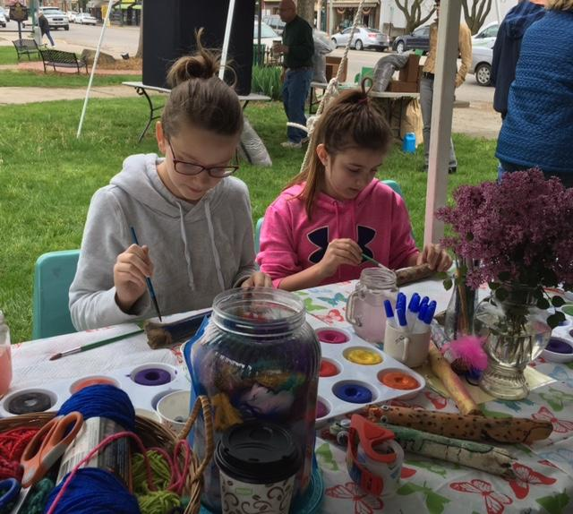 Photo submitted by Prudence Burgardt Children make creatures out of wood at a craft table at last year's Community Earth Day Celebration.